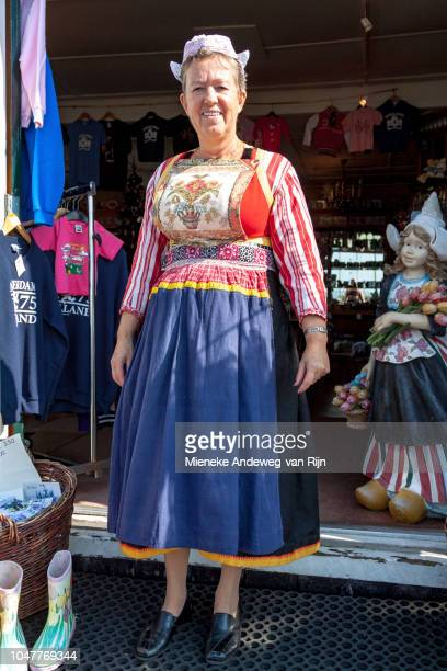 Dutch woman posing in a traditional, colourful costume of Marken, North Holland, The Netherlands.