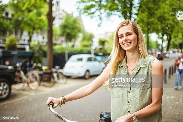 dutch woman with bicycle in amsterdam - dutch culture stock pictures, royalty-free photos & images
