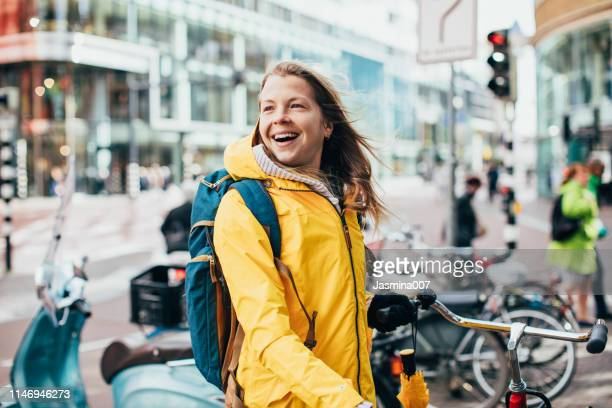 dutch woman with bicycle in utrecht - utrecht stock pictures, royalty-free photos & images
