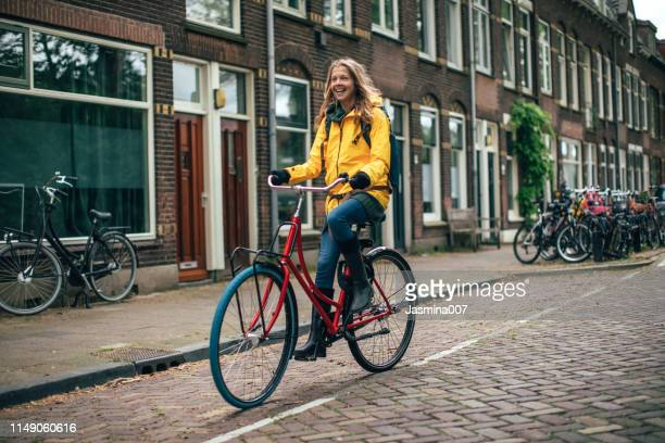 dutch woman with bicycle in utrecht - dutch culture stock pictures, royalty-free photos & images