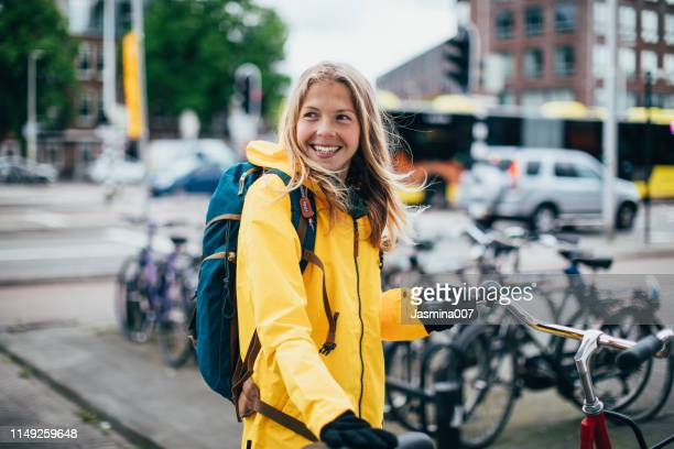 dutch woman with bicycle - city life stock pictures, royalty-free photos & images