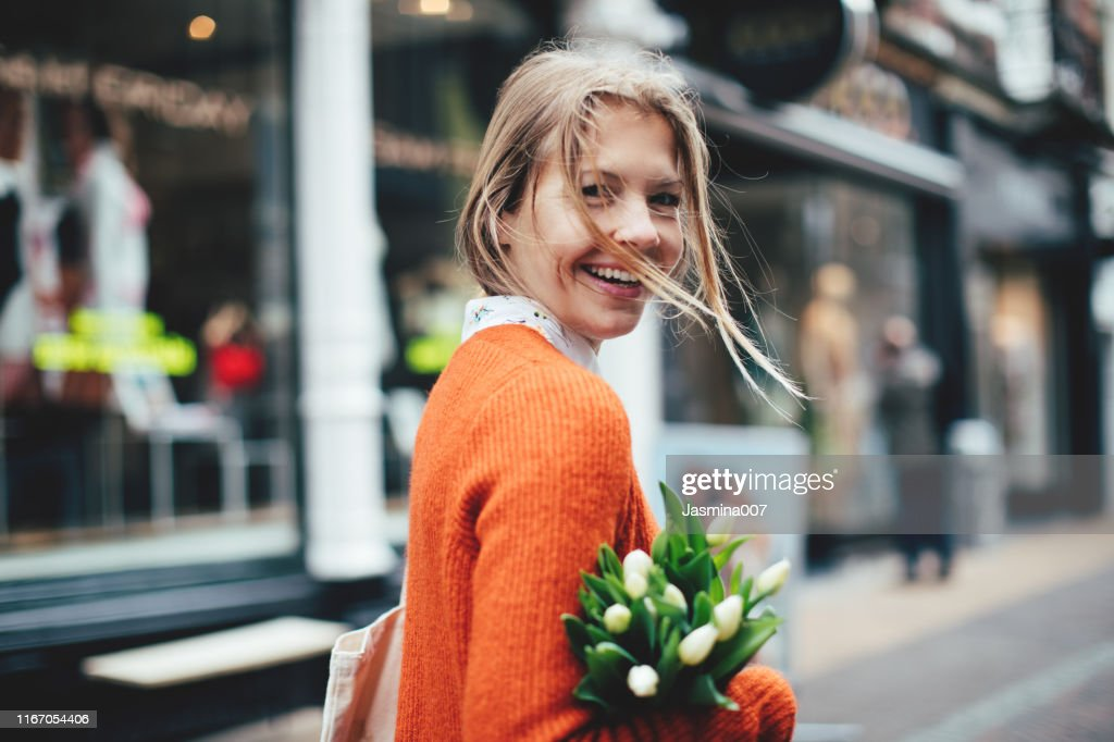 Dutch woman with tulips in Utrecht : Stock Photo