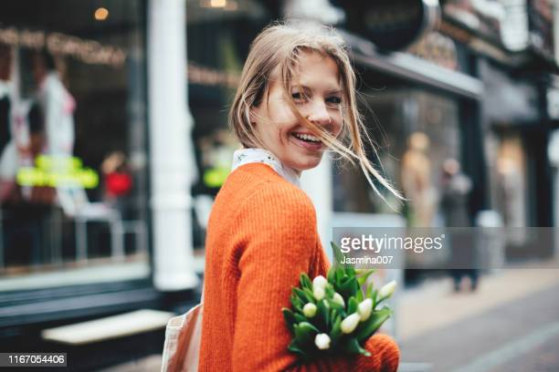 dutch woman with tulips in utrecht - women stock pictures, royalty-free photos & images