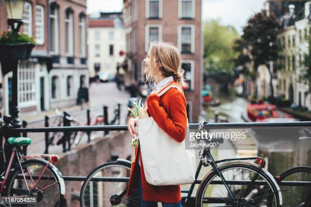 dutch woman with tulips - amsterdam stock pictures, royalty-free photos & images