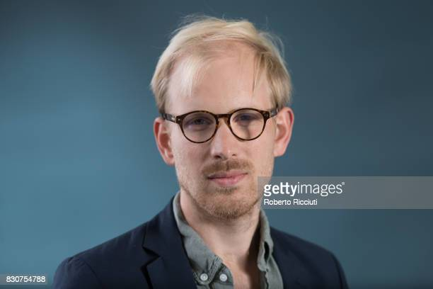 Dutch writer and journalist Rutger Bregman attends a photocall during the annual Edinburgh International Book Festival at Charlotte Square Gardens on...