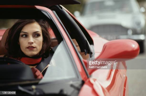 Dutchborn actress Famke Janssen driving a Ferrari F355 GTS as the villainous Xenia Onatopp in the James Bond film 'GoldenEye' 1995