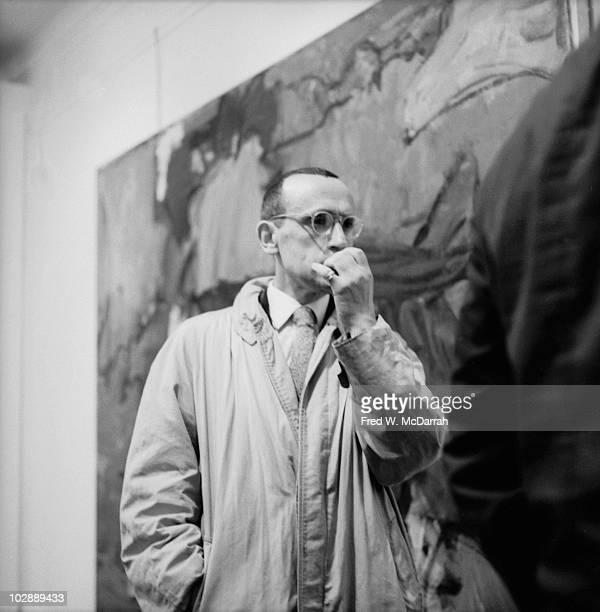 Dutchborn American artist Joop Sanders attends a show of works by Grace Hartigan at the Tibor de Nagy Gallery New York New York April 28 1959
