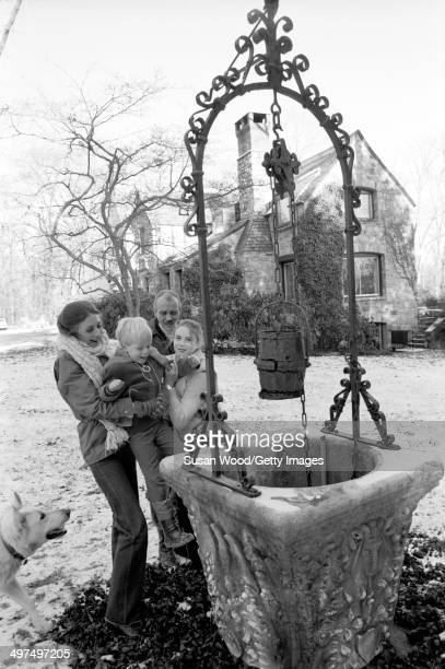 Dutchborn businesswoman and former model Wilhelmina Cooper and her husband former television executive Bruce Cooper play with their children Jason...