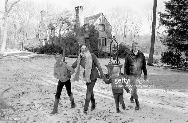 Dutchborn businesswoman and former model Wilhelmina Cooper and her husband former television executive Bruce Cooper walk with their children Jason...
