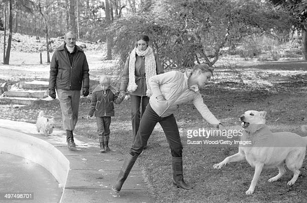 Dutch-born businesswoman and former model Wilhelmina Cooper and her husband, former television executive Bruce Cooper , walk with their children,...