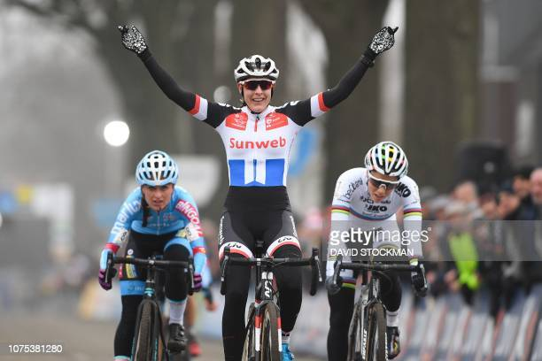 Dutch'cyclist Lucinda Brand celebrates as she crosses the finish line and win the fifth stage of the women elite race of the Azencross in the DVV...