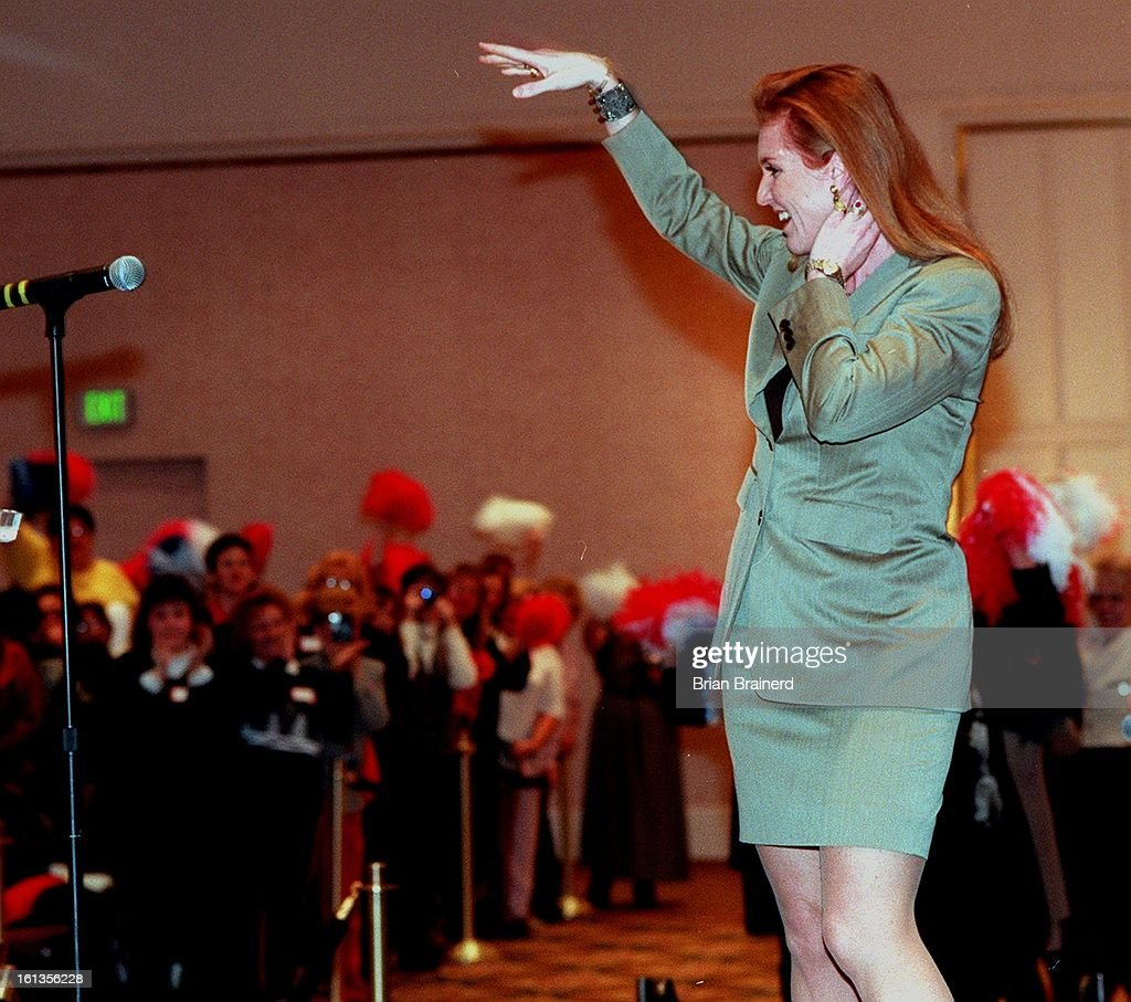 Dutchess of York, Sarah Ferguson, responds to an enthusiastic greeting from Colorado Weightwatchers at the Hyatt hotel ballroom Thursday moring. She gave a motivational talk from her own experience with weight and self esteem. : News Photo