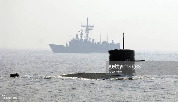 A Dutchmade 20yearold submarine of the Taiwanese navy surfaces during a drill off Kaohsiung southern Taiwan 12 September 2007 The air force held a...