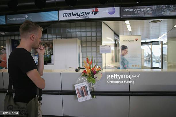 Dutchman Arthur Laumann pauses for thought after placing a floral tribute and photograph of Indonesian man Wayan Sujana of Bali believed to be...