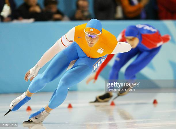 Dutchman Rintje Ritsma skates ahead of Russian Yevgeny Lalenkov in the men's 1500m speedskating race at the Utah Olympic Oval 19 February 2002 during...