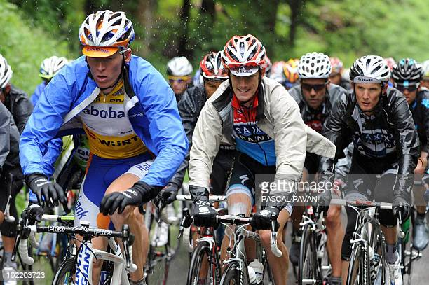 Dutchman yellow jersey leader Robert Gesink Luxemburg's Andy Schleck and Franck Schleck compete during the seventh stage Savognin Wetzikon of the...