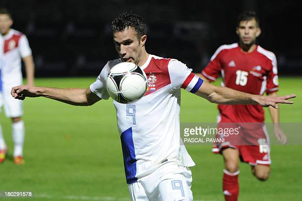 Dutch's forward Robin Van Persie eyes the ball the ball during the 2014 World Cup qualifying football match Andorra vs the Netherlands at Municipal...