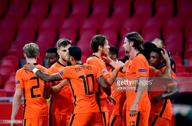 Dutch's forward Steven Bergwijn celebrates with teammates after scoring a goal during the UEFA Nations League football match between Netherlands and...