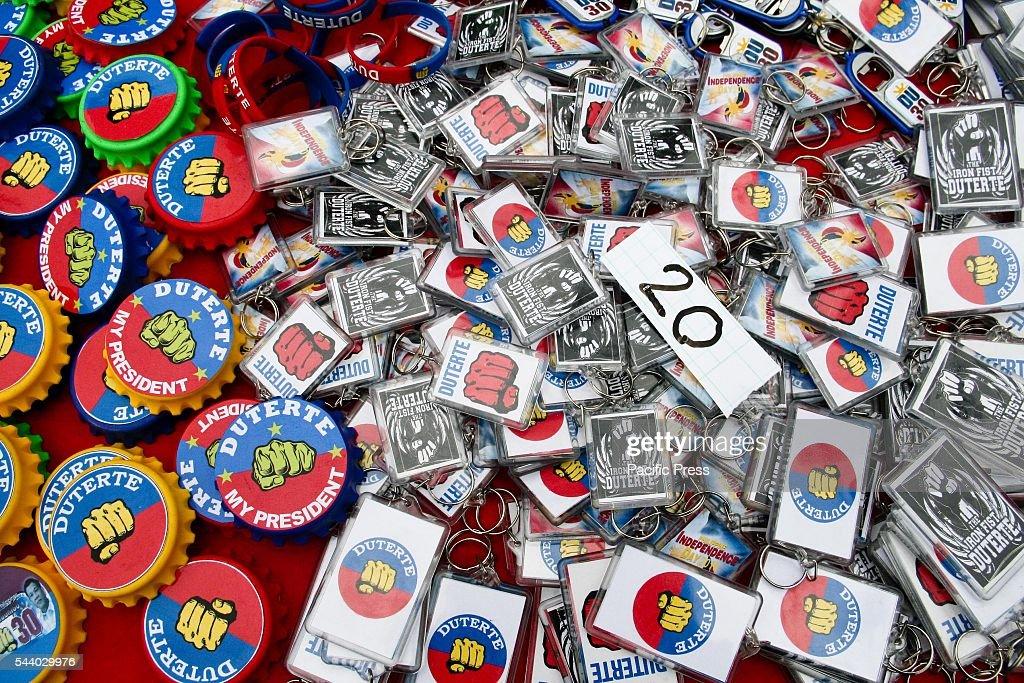 Duterte fridge magnets, bottle openers, and key chains on