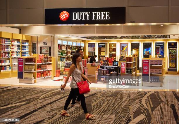 Duty Free Alcohol Shops and Travellers at the International Changi Airport on November 02 2013 in Singapore