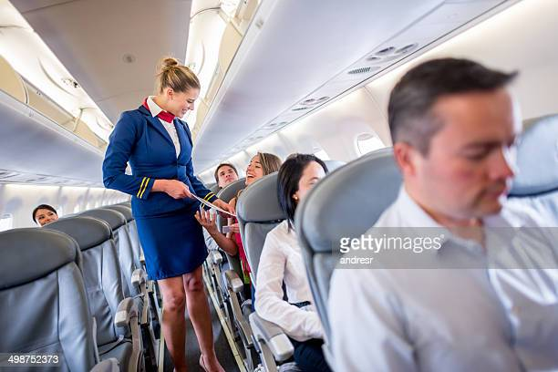 duty free service onboard - crew stock pictures, royalty-free photos & images