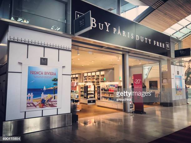 duty free shops at roissy charles de gaulle airport, paris, france - charles de gaulle airport stock photos and pictures