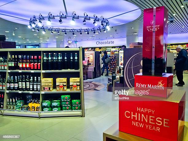 duty free store in shiphol airport, amsterdam - cognac remy martin stock pictures, royalty-free photos & images
