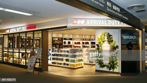 A dutyfree shop opens in an arrival area for international flights at Narita International Airport near Tokyo on Sept 1 2017 The shop which has...