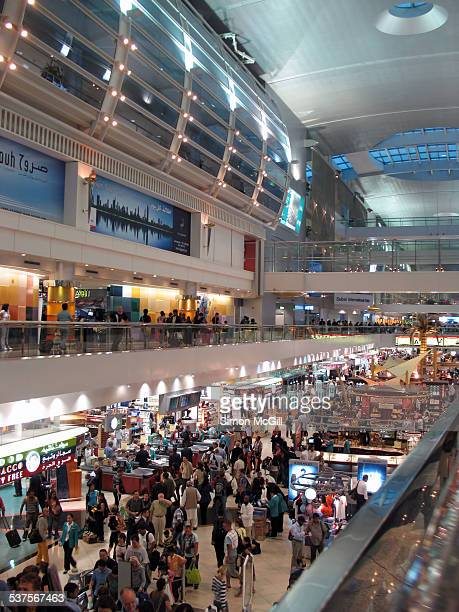 Dutyfree shopping concourse bustles with crowds of tourists at Dubai International Airport Al Garhoud United Arab Emirates