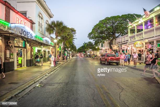 duval street at night - key west stock photos and pictures