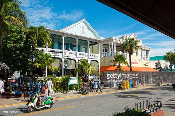 duval street in key west, florida - key west stock photos and pictures