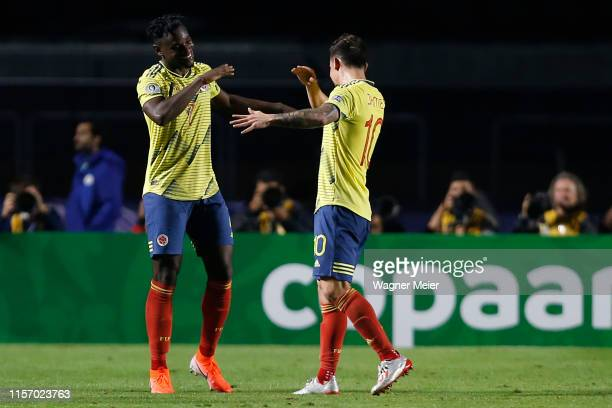 Duvan Zapata and James Rodriguez of Colombia celebrate after winning the Copa America Brazil 2019 group B match between Colombia and Qatar at Morumbi...