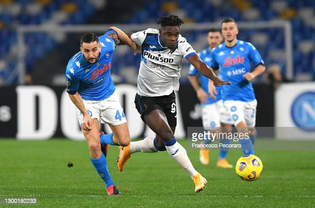 Duvan Zapata of Atalanta B.C. Battles for possession with Konstantinos Manolas of SSC Napoli during the Coppa Italia match between SSC Napoli and...