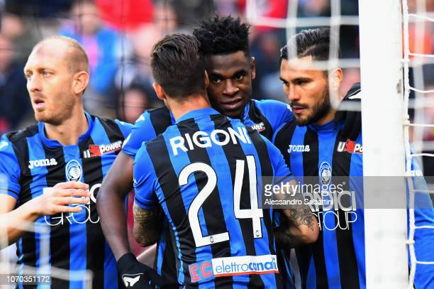 Duvan Zapata of Atalanta BC celebrates after scoring the opening goal with tem mates during the Serie A match between Udinese and Atalanta BC at...