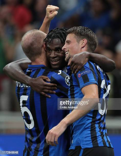 Duvan Zapata of Atalanta BC celebrates with his team-mate Andrea Masiello and Hans Hateboer after scoring the opening goal during the UEFA Champions...