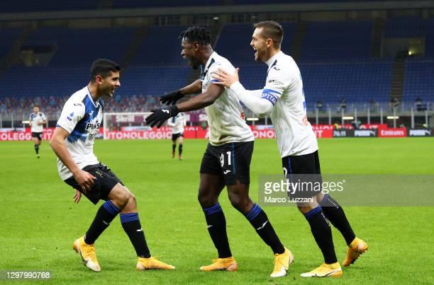 Duvan Zapata of Atalanta B.C. Celebrates with team mates Cristian Romero of Atalanta and Rafael Toloi after scoring their team's third goal during...
