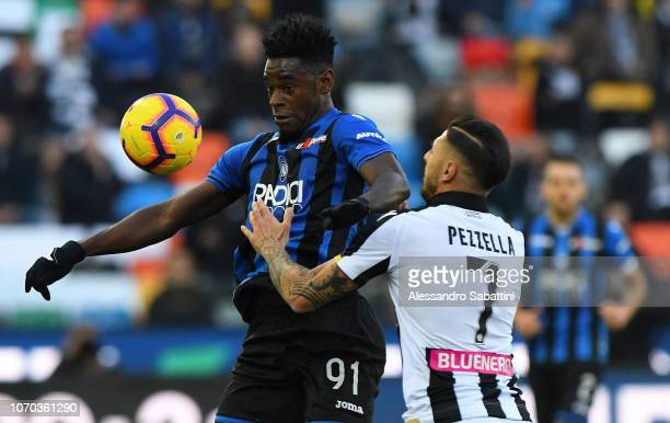 Duvan Zapata of Atalanta BC competes for the ball with Giuseppe Pezzella of Udinese Calcio during the Serie A match between Udinese and Atalanta BC...