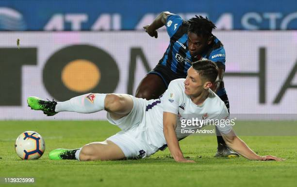 Duvan Zapata of Atalanta BC competes for the ball with Nikola Milenkovic of ACF Fiorentina during the TIM Cup match between Atalanta BC and ACF...