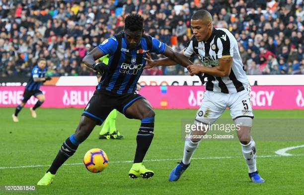 Duvan Zapata of Atalanta BC competes for the ball with William Ekong of Udinese Calcio during the Serie A match between Udinese and Atalanta BC at...