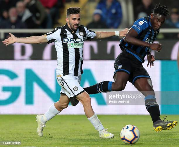 Duvan Zapata of Atalanta BC is challenged by Marco D Alessandro of Udinese Calcio during the Serie A match between Atalanta BC and Udinese at Stadio...