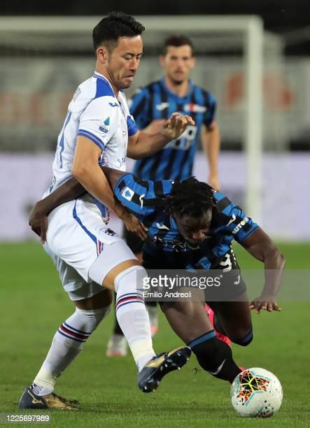 Duvan Zapata of Atalanta BC is challenged by Maya Yoshida of UC Sampdoria during the Serie A match between Atalanta BC and UC Sampdoria at Gewiss...