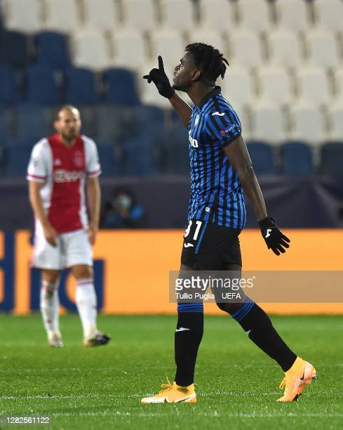 Duvan Zapata of Atalanta celebrates after scoring his sides first goal during the UEFA Champions League Group D stage match between Atalanta BC and...