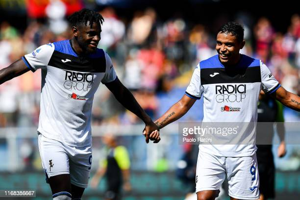 Duvan Zapata of Atalanta celebrates with his team-mate Luis Muriel after the Serie A match between Genoa CFC and Atalanta BC at Stadio Luigi Ferraris...