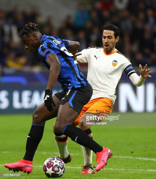 Duvan Zapata of Atalanta competes for the ball with Daniel Parejo of Valencia CF during the UEFA Champions League round of 16 first leg match between...