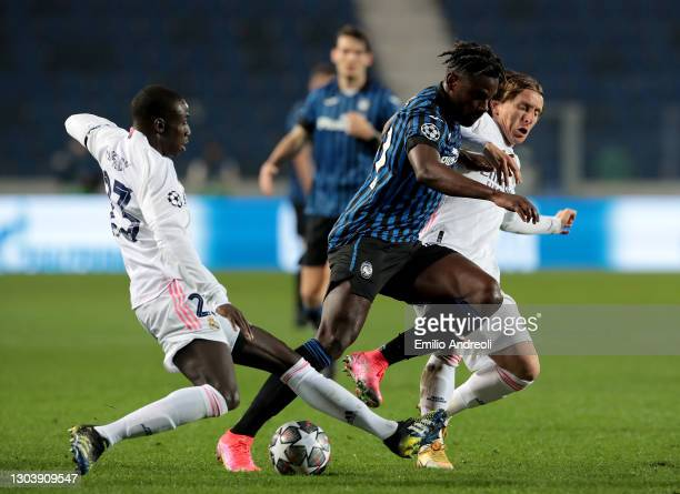 Duvan Zapata of Atalanta is challenged by Ferland Mendy and Luka Modric of Real Madrid during the UEFA Champions League Round of 16 match between...