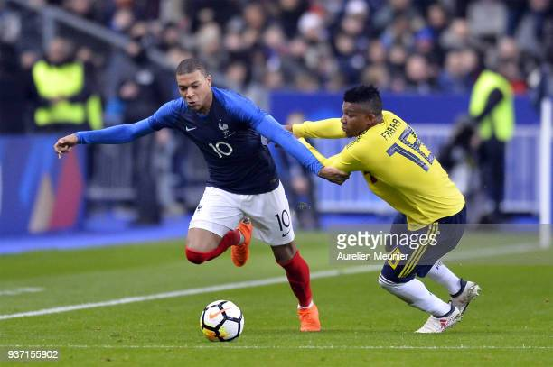 Duvan Zapata of Colombia and Kylian Mbappe of France fight for the ball during the international friendly match between France and Colombia at Stade...