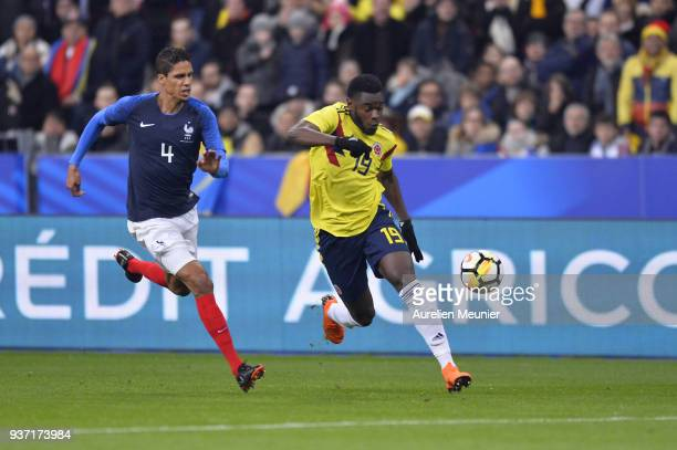 Duvan Zapata of Colombia and Raphael Varanne of France fight for the ball during the international friendly match between France and Colombia at...
