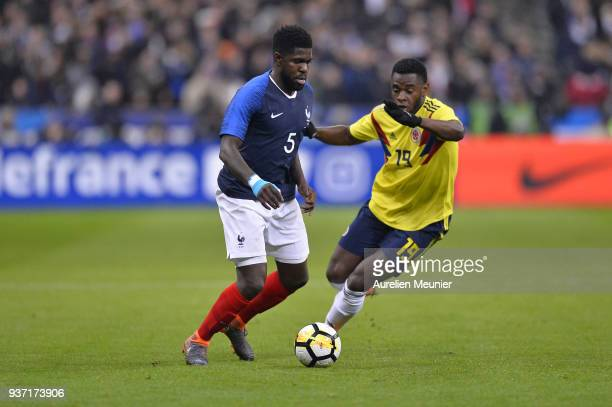 Duvan Zapata of Colombia and Samuel Umtiti of France fight for the ball during the international friendly match between France and Colombia at Stade...