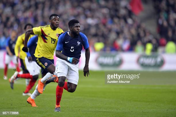 Duvan Zapata of Colombia and Samuel Umtiti of France run for the ball during the international friendly match between France and Colombia at Stade de...