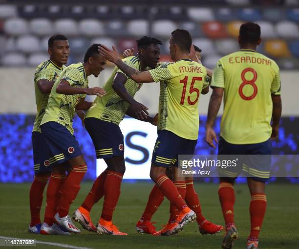 Duvan Zapata of Colombia celebrates with his teammates after goal during a friendly match between Peru and Colombia at Estadio Monumental on June 9,...